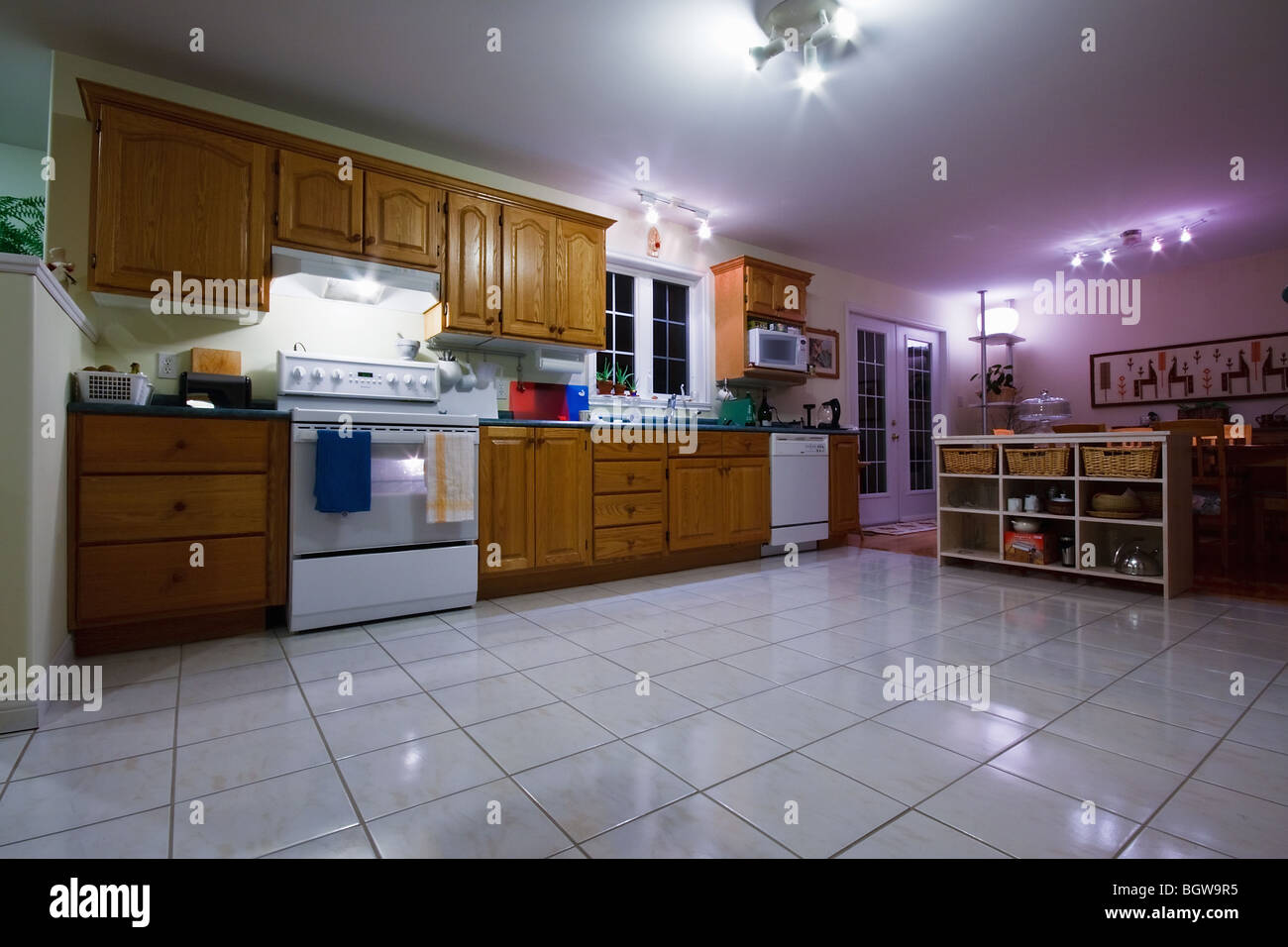 A bright Canadian kitchen lighted with energy saving compact fluorescent bulbs - Stock Image