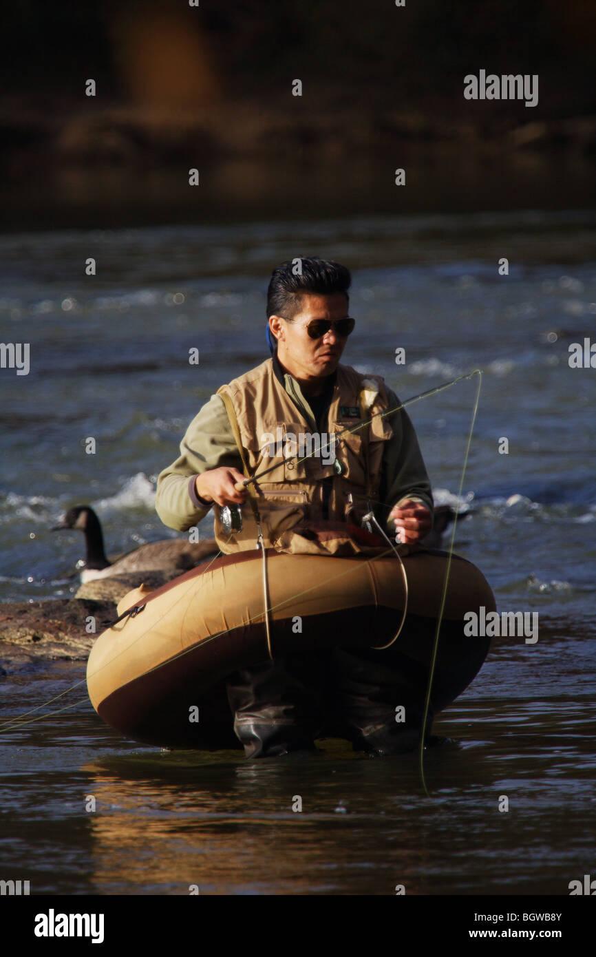 FLY FISHERMAN FISHING FROM FLOAT TUBE CHATTAHOOCHEE RIVER