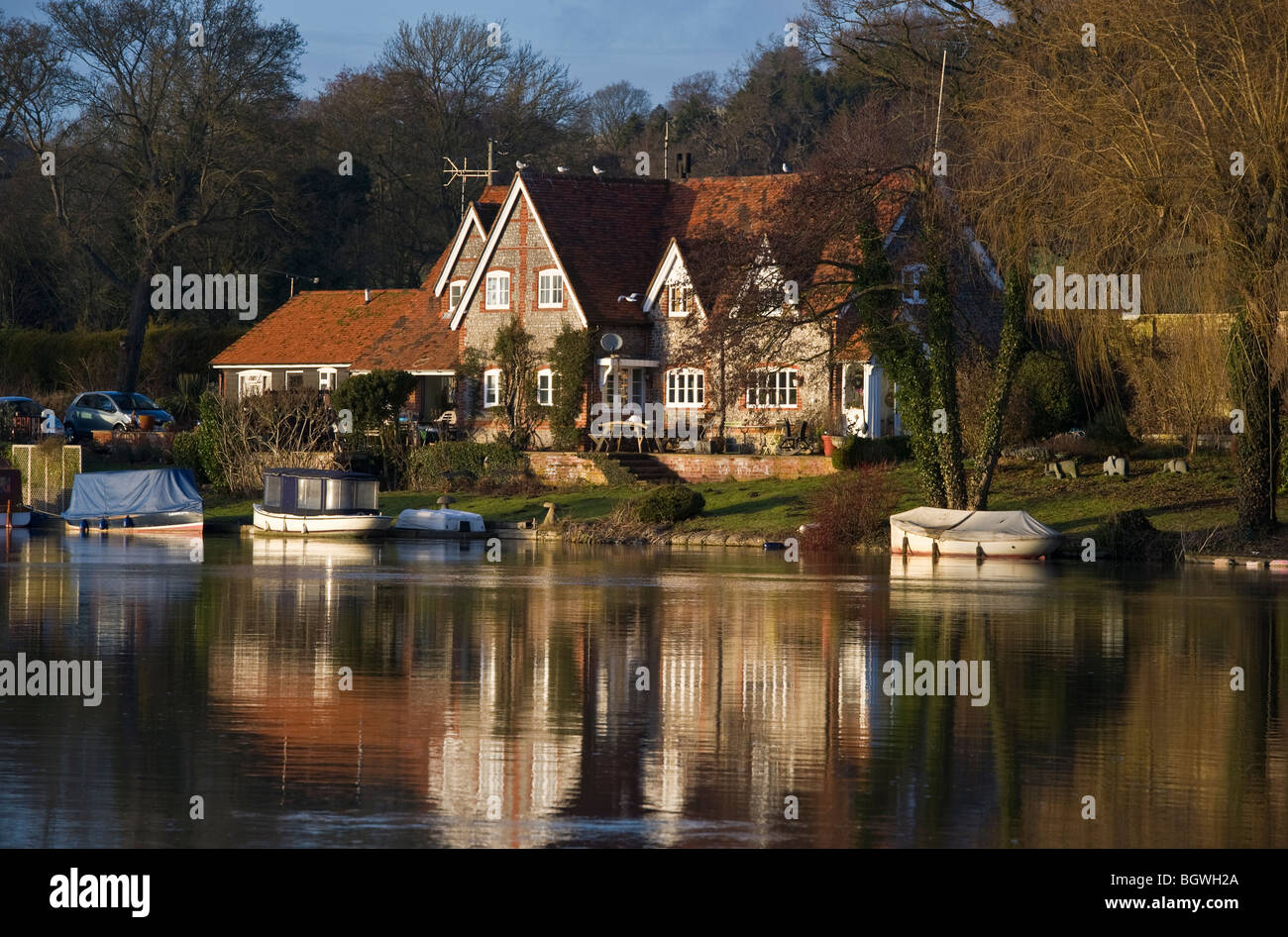 Riverside properties and houses at the River Thames upstream of Hambleden Weir Buckinghamshire UK - Stock Image