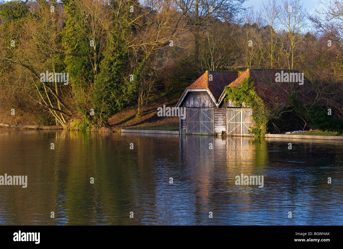 a pair of traditional riverside wooden boat houses on the Thames upstream of Hambleden Weir Mill End Buckinghamshire - Stock Image