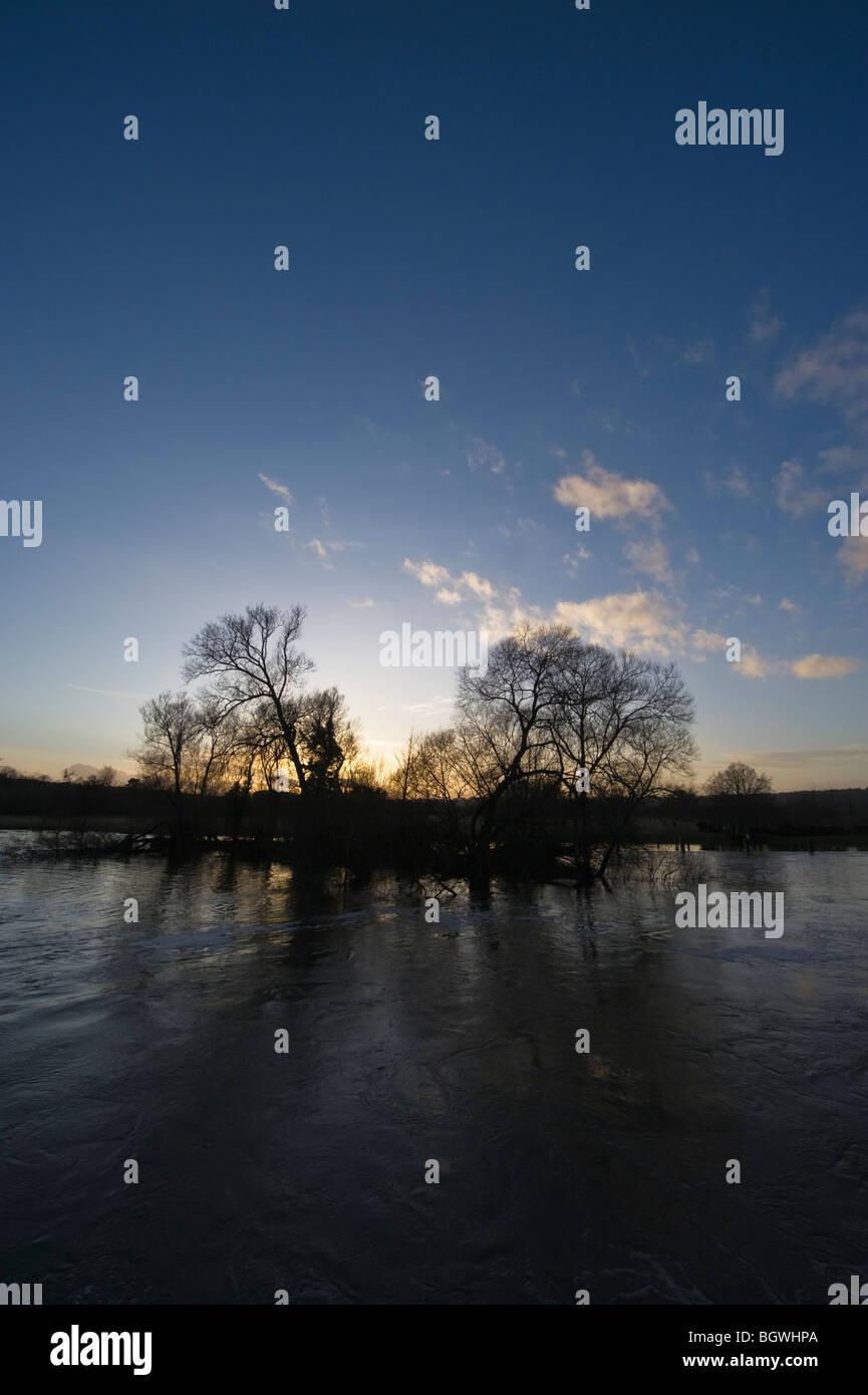Winter sunset over the River Thames at Hambleden Weir Mill End Buckinghamshire UK - Stock Image