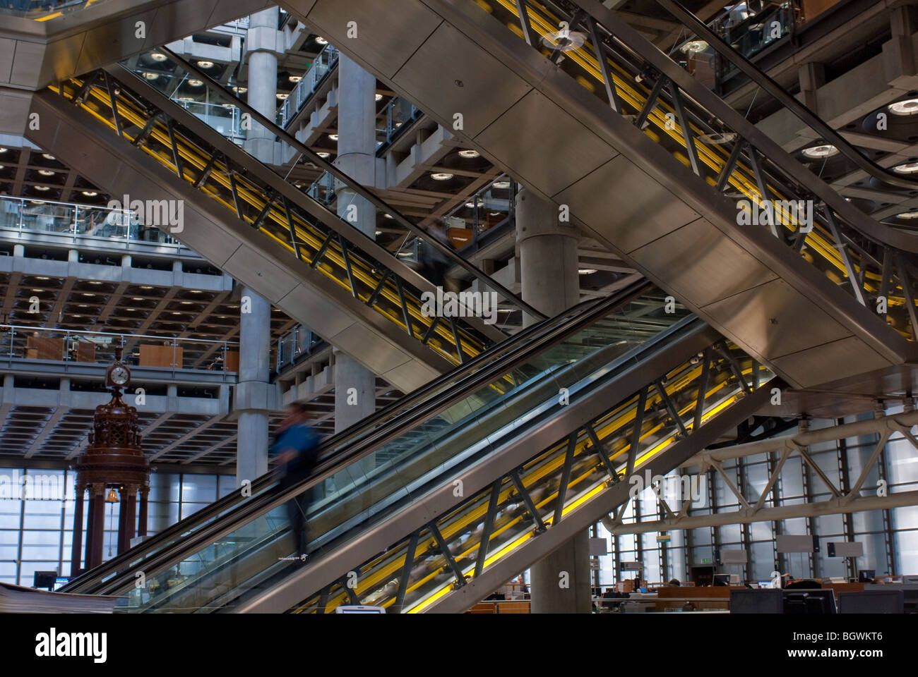 LLoyds of London interior,showing escalator and Lutine Bell - Stock Image