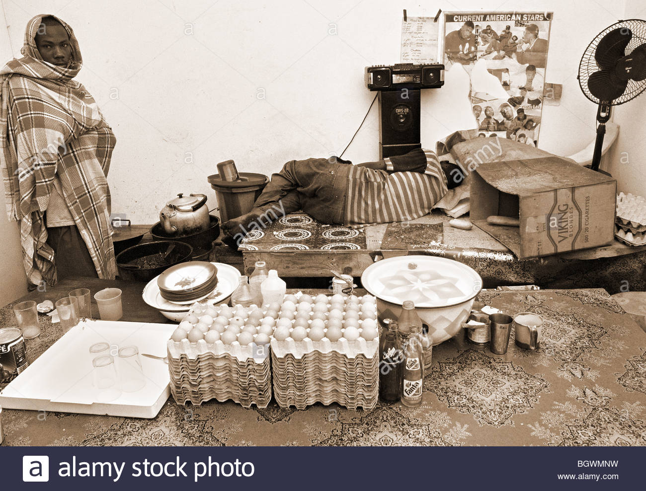 FOOD Mauritania North Africa Cafe restaurant SLEEPING CHEF COOK filthy eggs 2000 - Stock Image