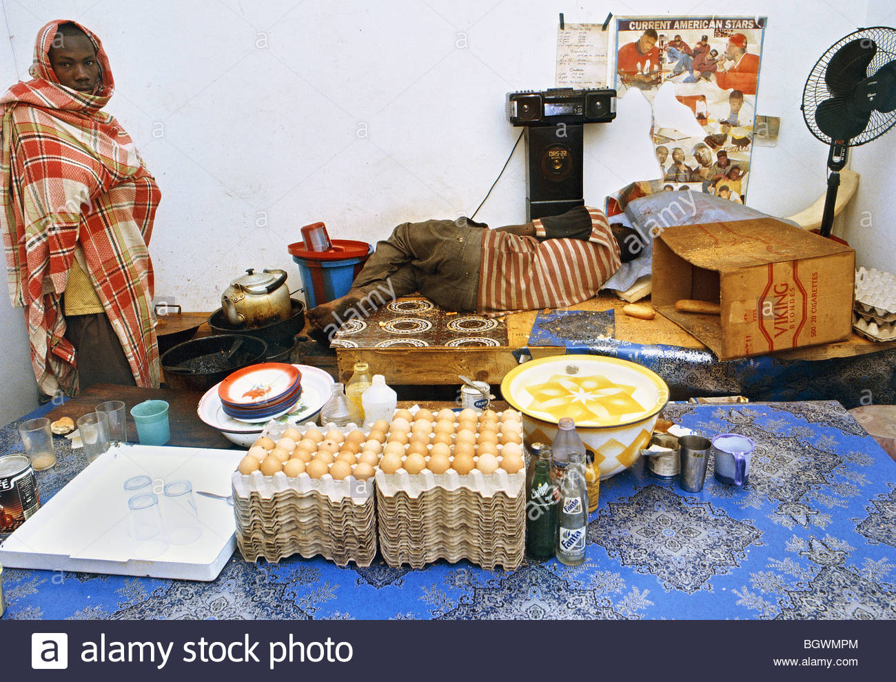 FOOD Mauritania North Africa Cafe restaurant SLEEPING CHEF COOK filthy eggs cooking African food 2000 - Stock Image