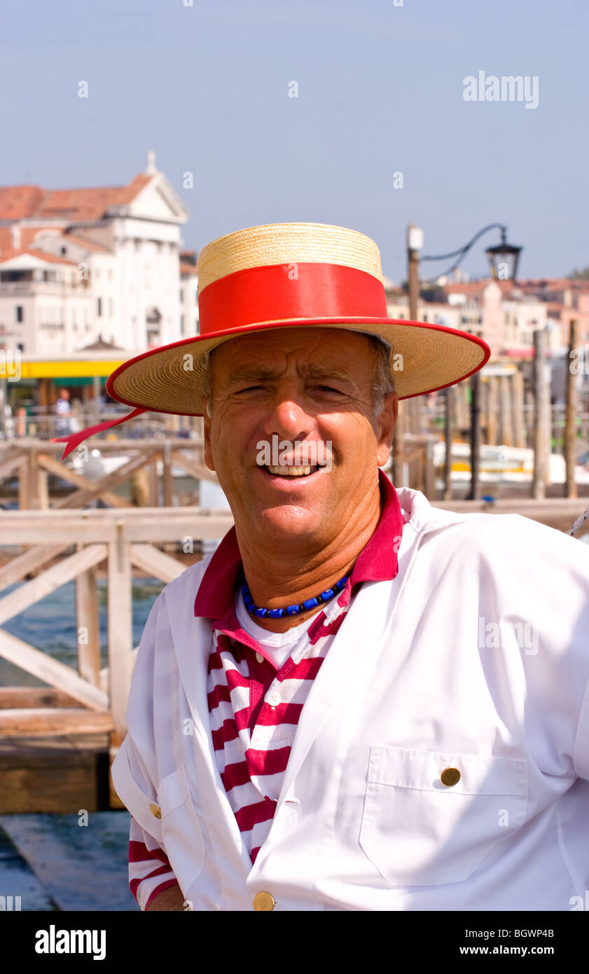 Venice Venezia Italy gondola driver with red straw hat for tourists on  Grand Canal 7f3d5d937