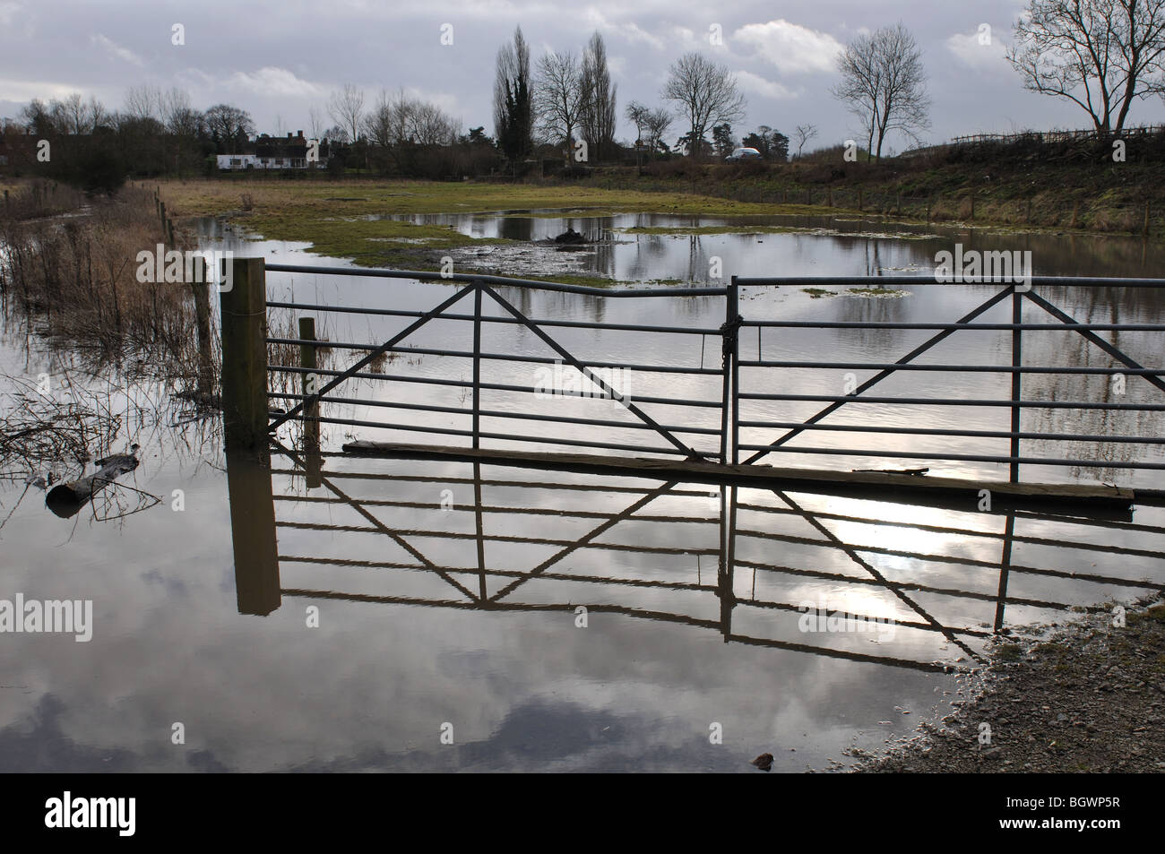Gate reflected in River Avon floodwater, Barford, Warwickshire, England, UK Stock Photo