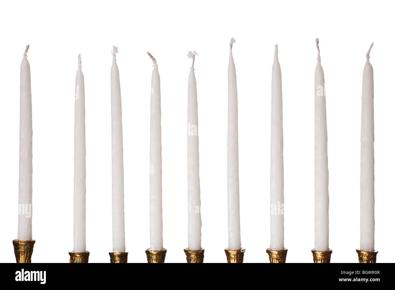Hanukkah menorah candles isolated on a white background - Stock Image