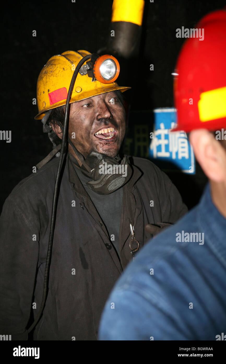 Chinese coal miner underground - Stock Image