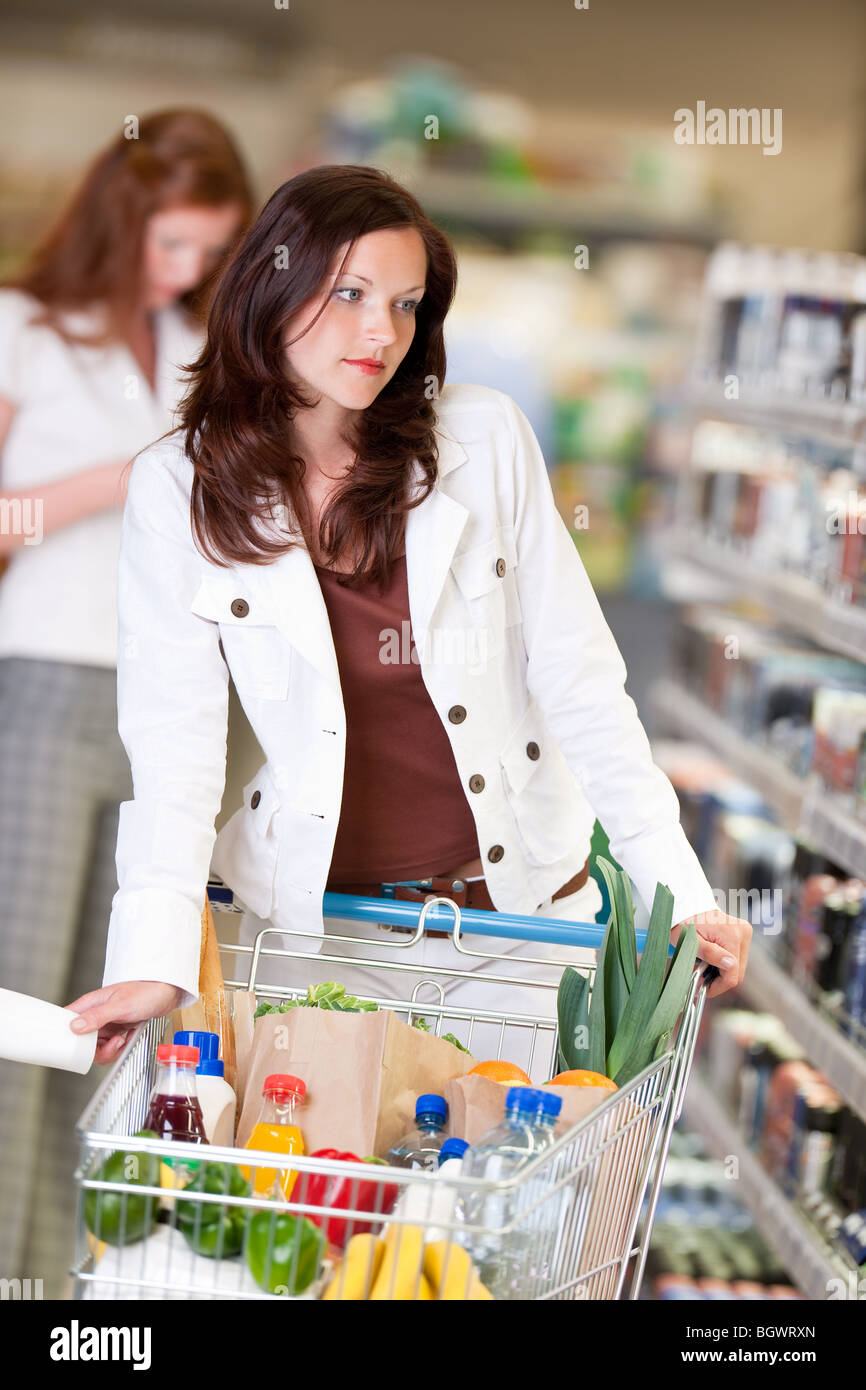 Shopping - Beautiful brunette woman in cosmetics department shopping Stock Photo