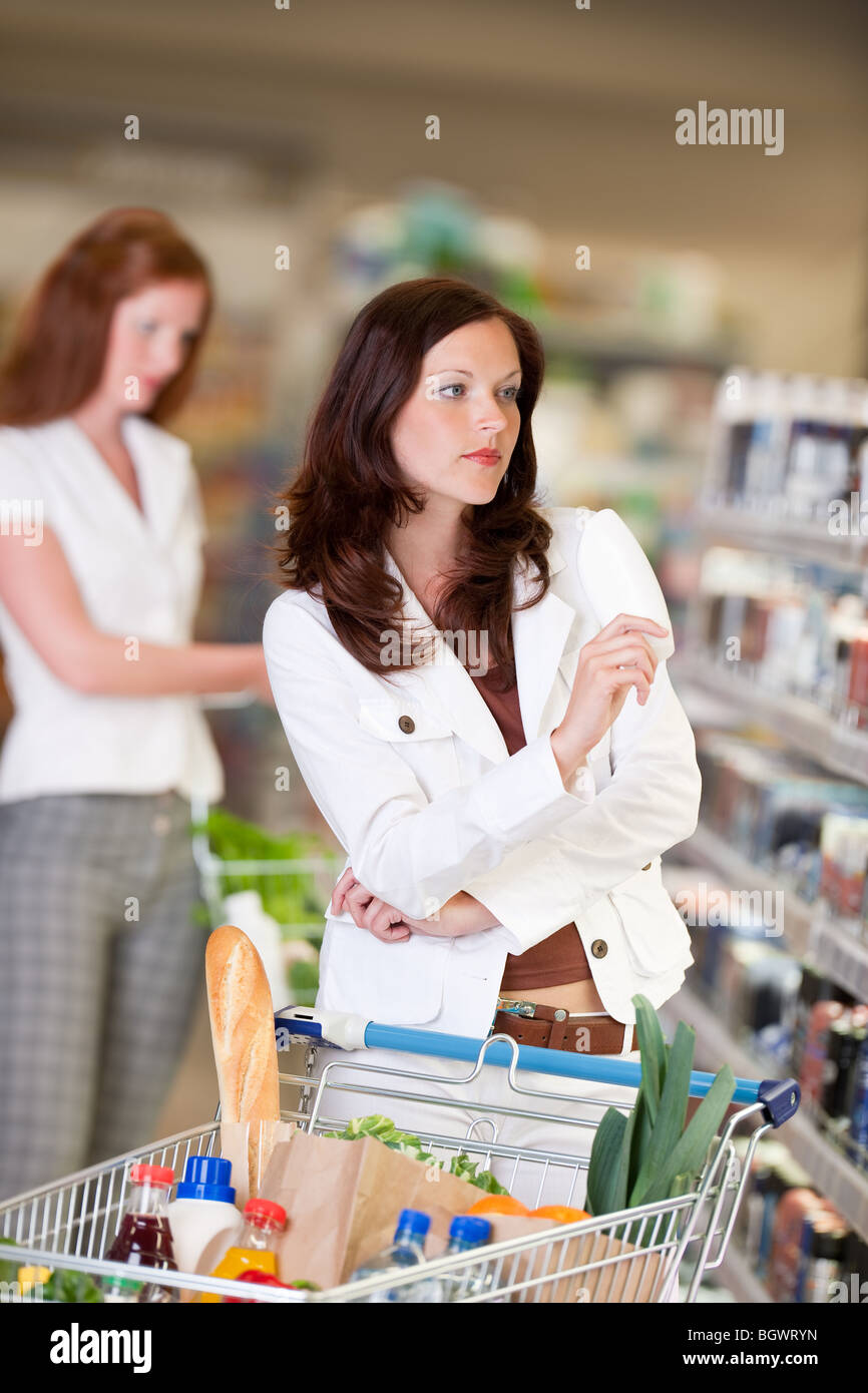 Shopping - Attractive woman shopping in cosmetics department Stock Photo