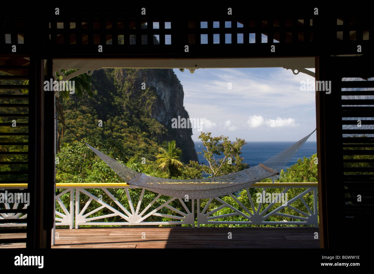 A hammock on the porch of a cottage in the Stonefield Plantation Resort, St Lucia, The Windward Islands, The Caribbean - Stock Image
