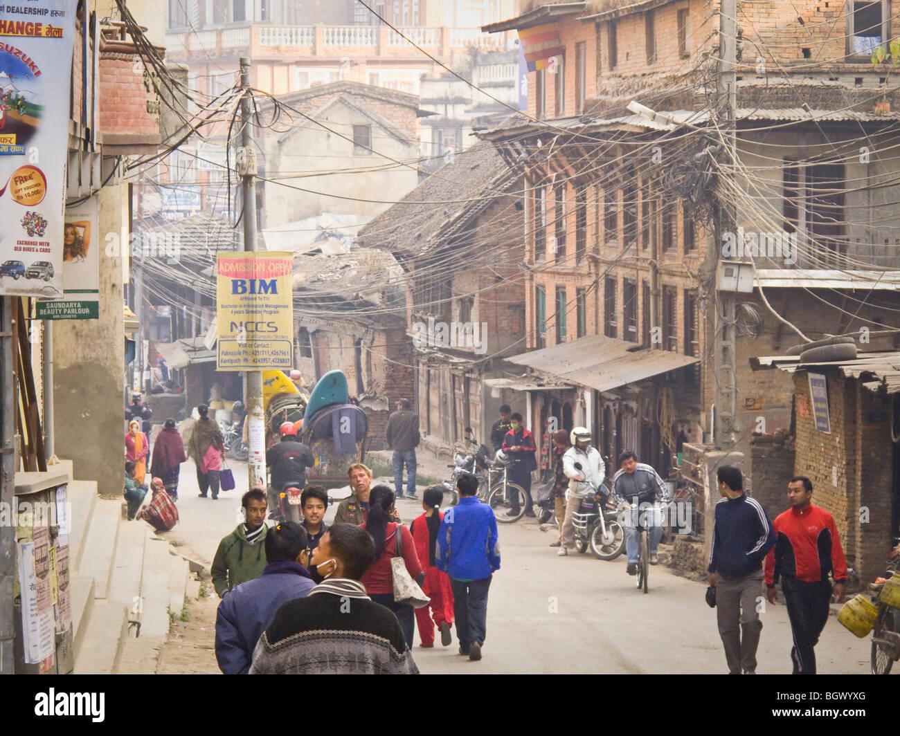 A busy street with many powerlines in Katmandu, Nepal. - Stock Image