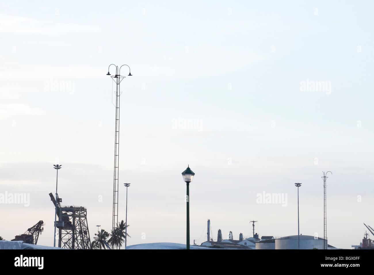 Minimal skyline with machinery and lanterns - Stock Image