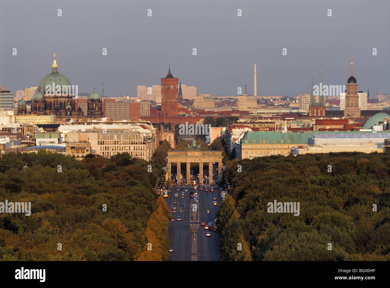 Berlin. Germany. View across the Tiergarten and Strasse des 17 Juni towards the Brandenburg Gate & Mitte. - Stock Image