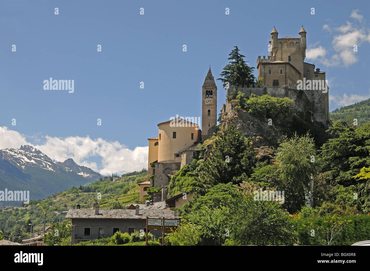 Saint St Pierre Castle Castello Parish Church and square bell tower 4 km west of Aosta Italy with alpine mountains Stock Photo