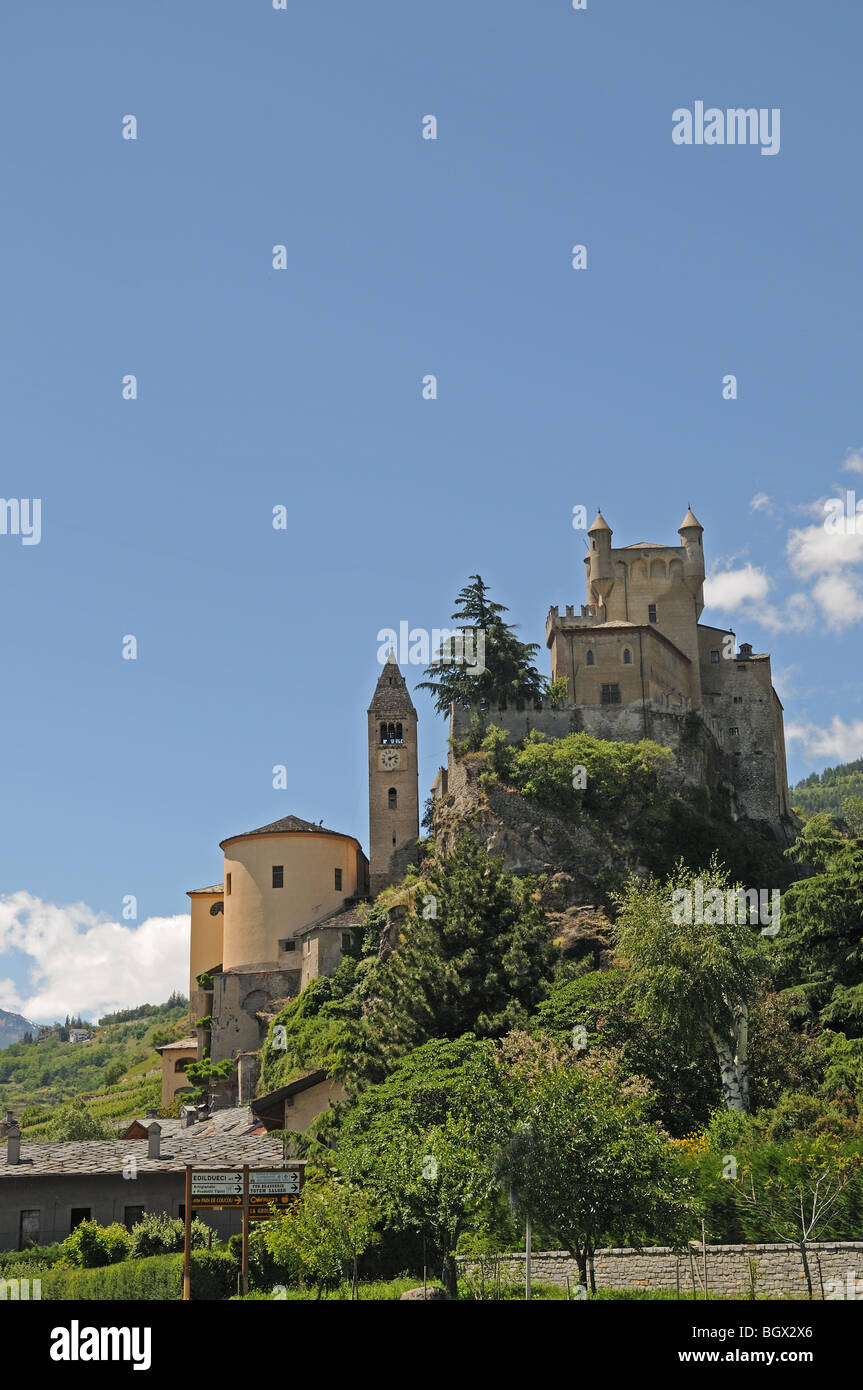 Saint St Pierre Castle Castello Parish Church and square bell tower 4 km west of Aosta Italy with alpine mountains - Stock Image