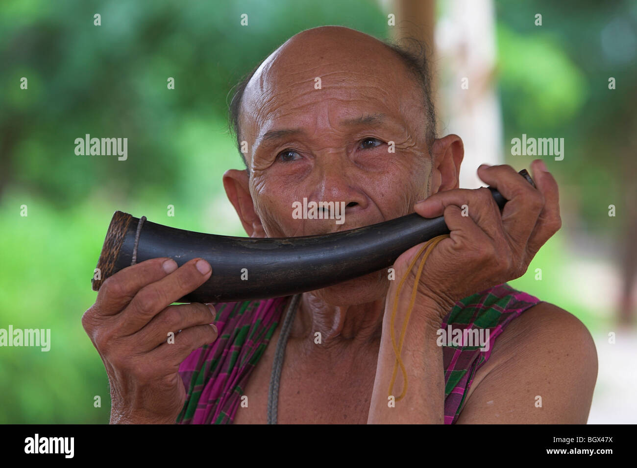 Man playing a horn - Stock Image