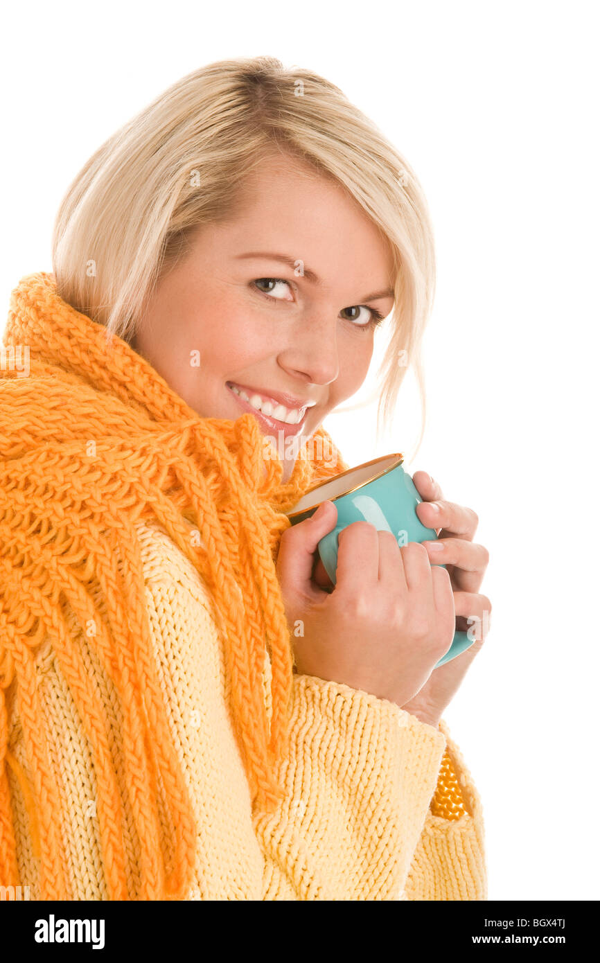 Portrait of young autumnal woman holding mug isolated on white background - Stock Image