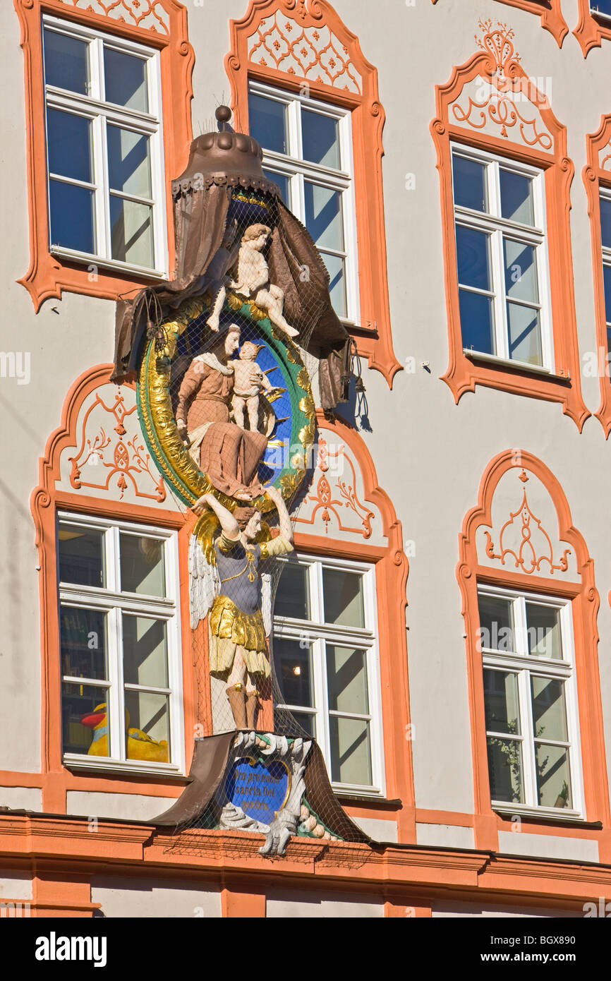 Religious motif on the facade of a building in the Old Town district in the City of Landshut, Bavaria, Germany, - Stock Image