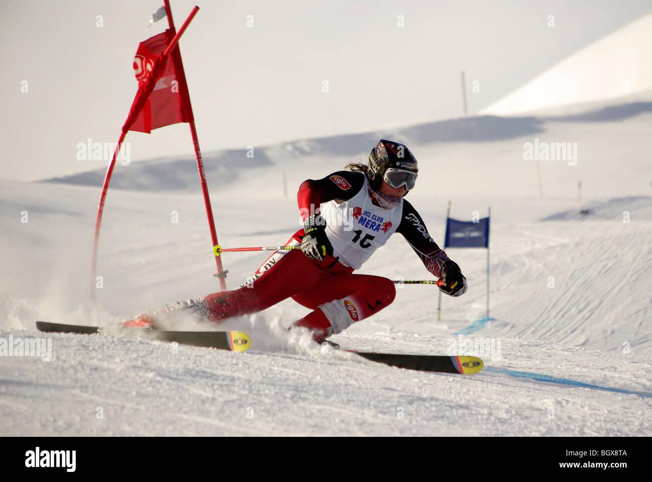 ski race, athlete curve near the pole - Stock Image