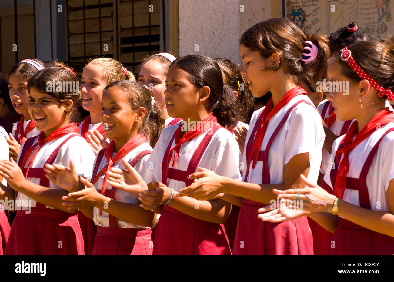 students performing singing at elementary school in small village of