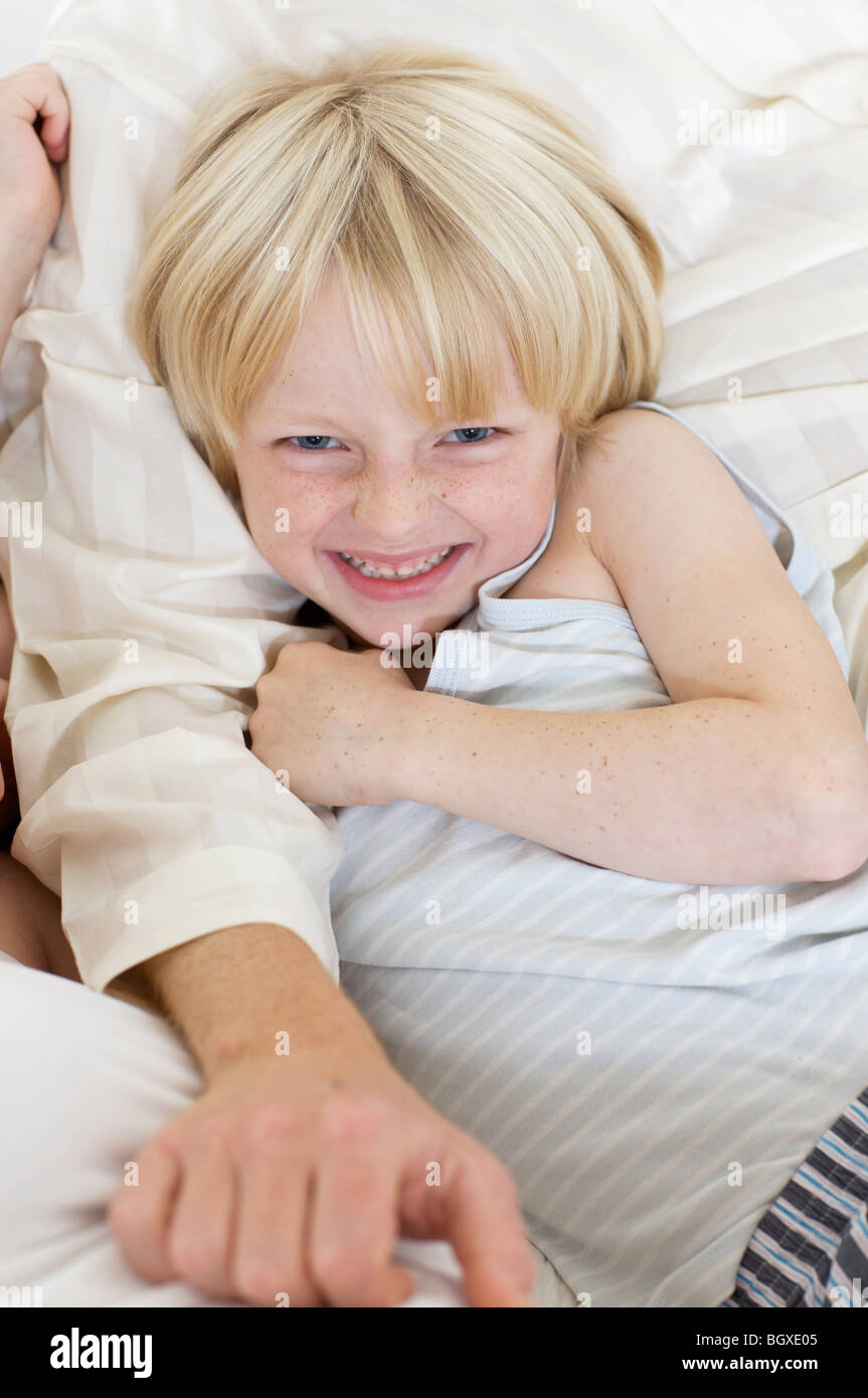 boy lying in bed - Stock Image