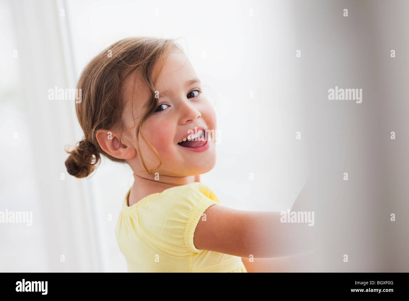 young girl smiling at viewer - Stock Image