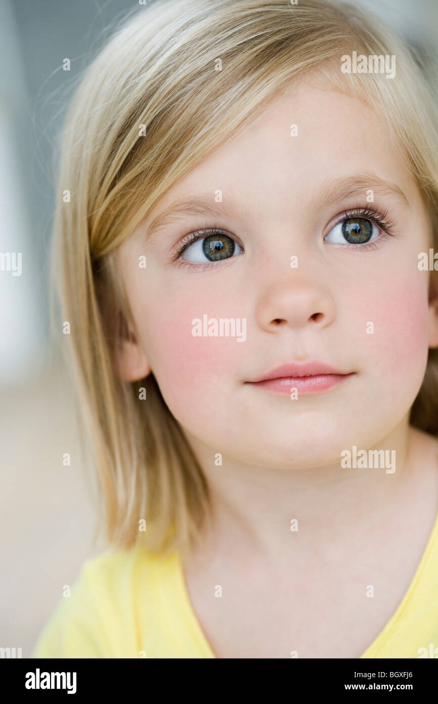 young girl looking interested - Stock Image