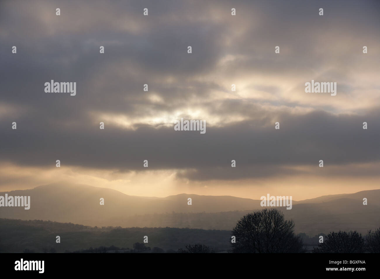 Heavens rays over Moel Famau from Halkyn mountain. - Stock Image