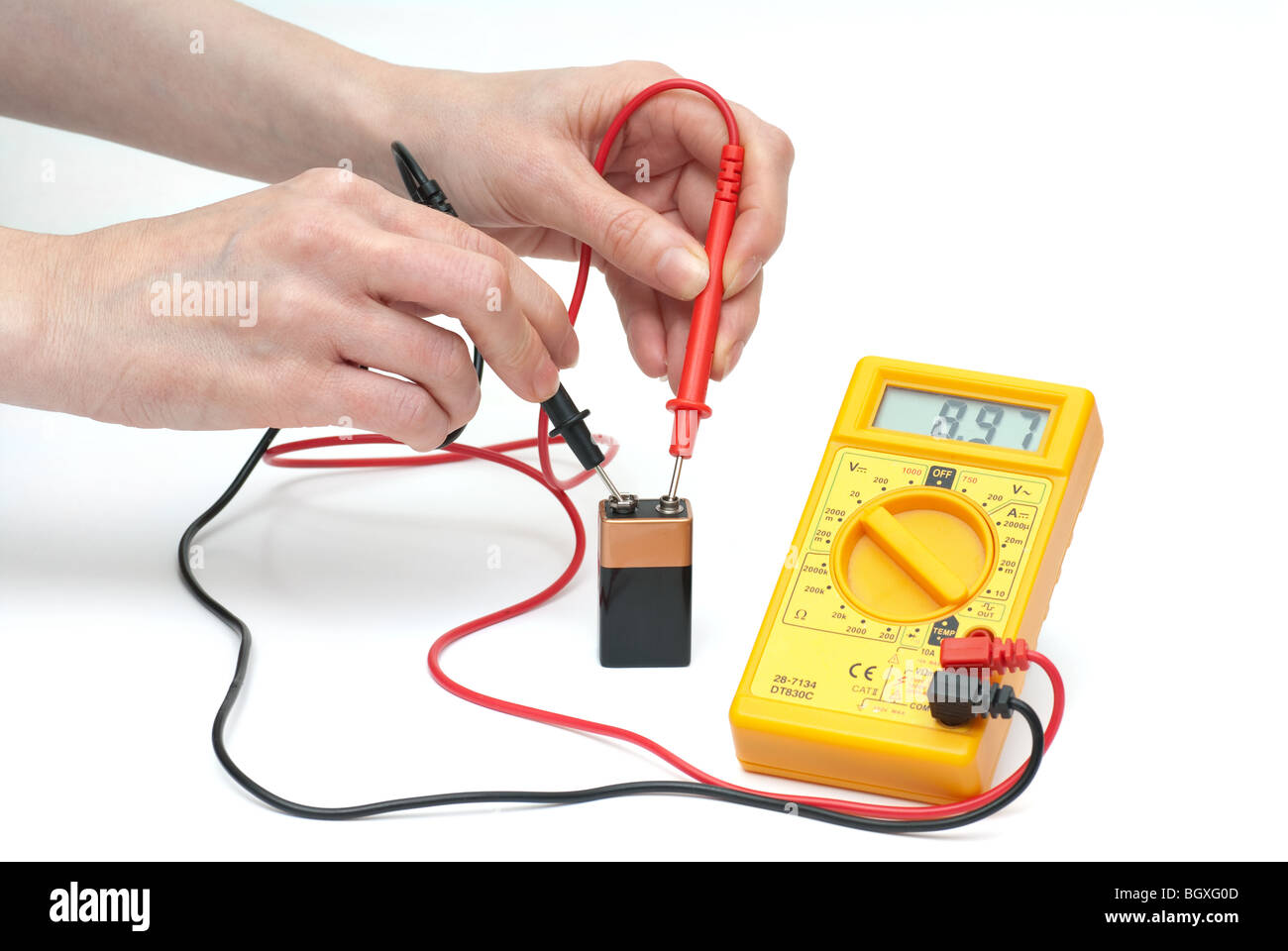 measuring battery voltage - Stock Image