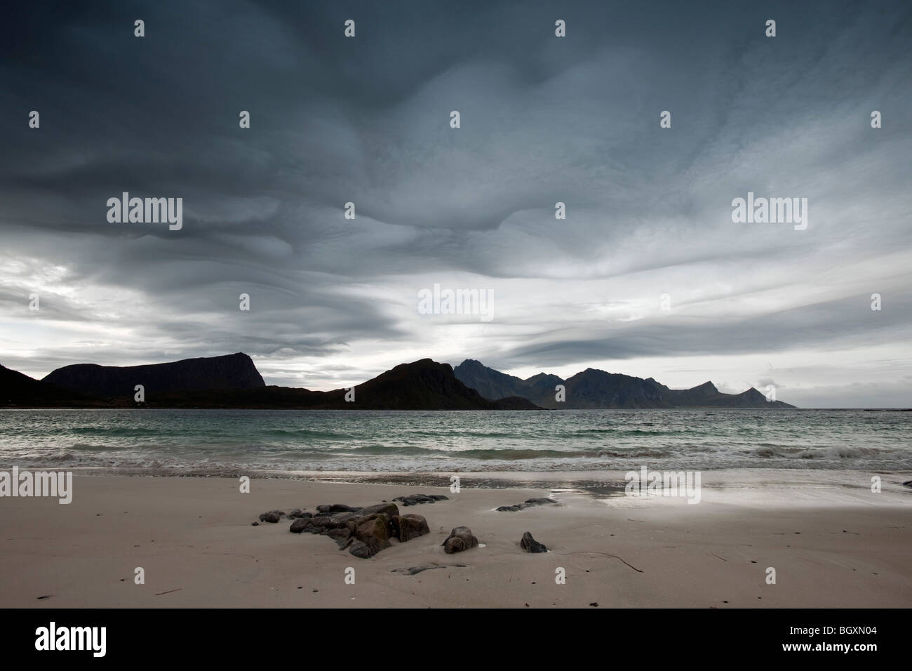 Dark clouds over a beach in Lofoten islands, North Norway - Stock Image