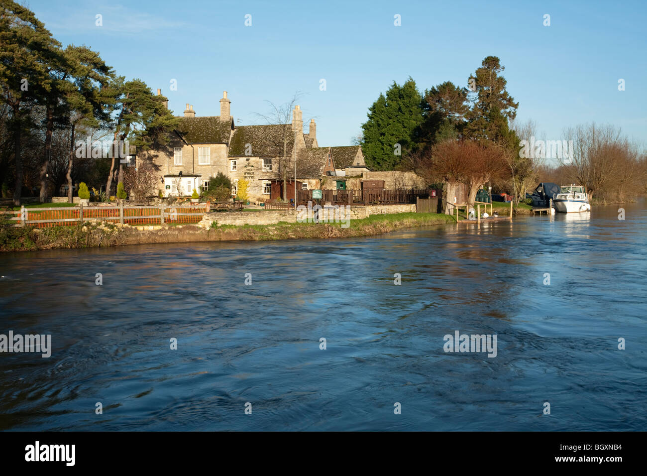 The Swan Hotel on the River Thames at Radcot Bridge, Oxfordshire, Uk - Stock Image