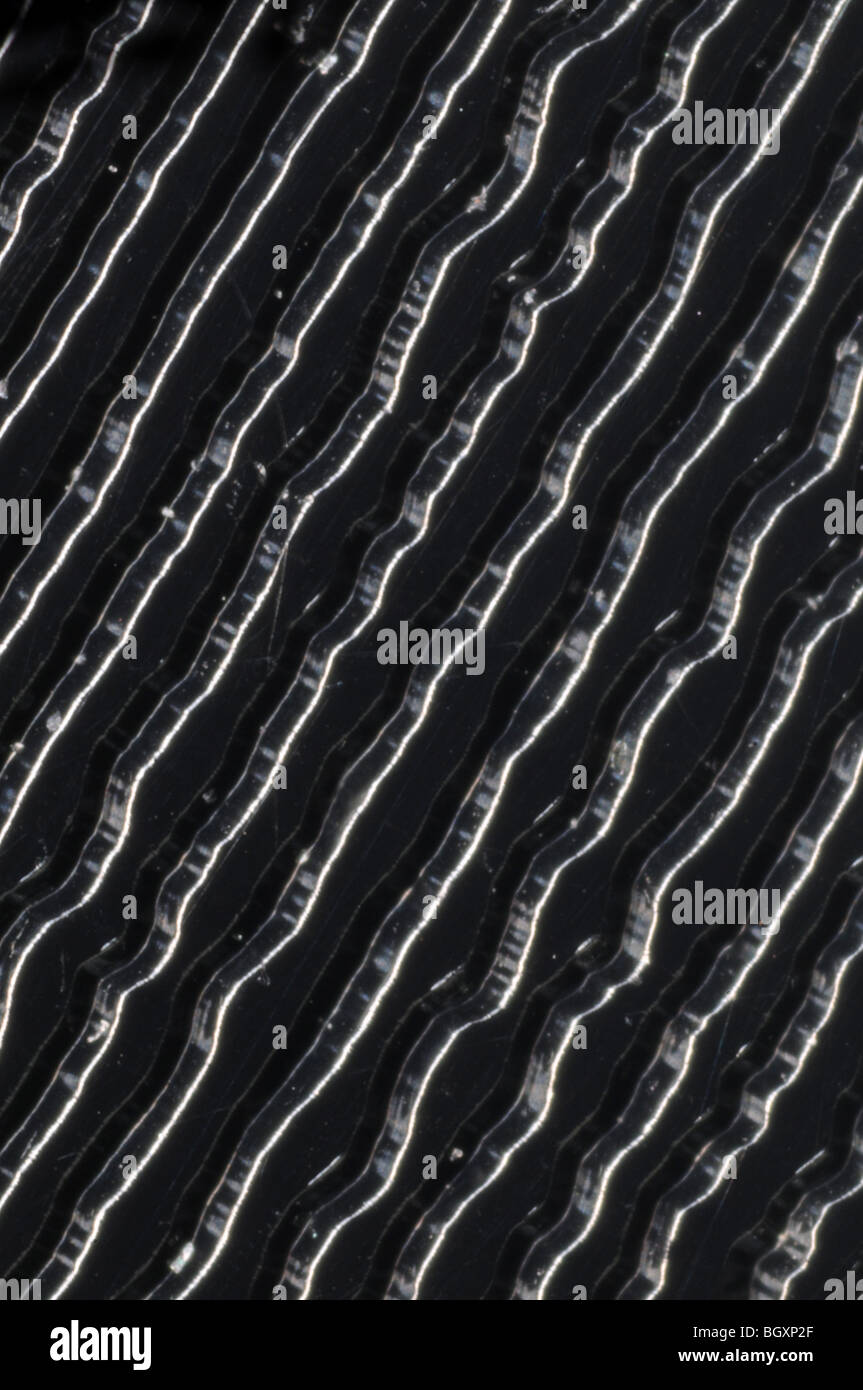 The grooves on a 45RPM stereo single vinyl record photographed at 25x resolution Stock Photo