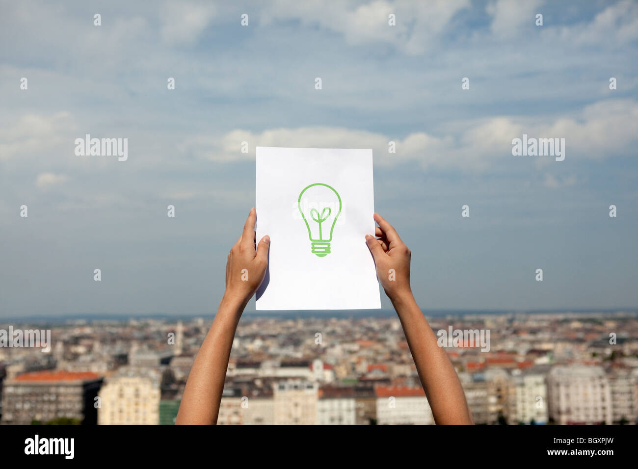 Woman holding paper green light - Stock Image