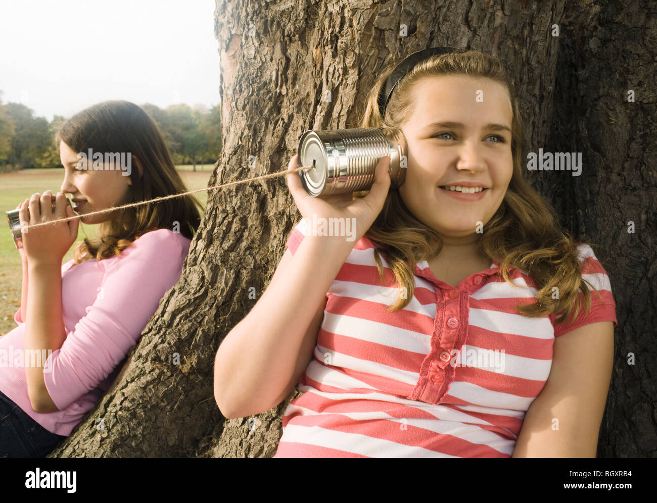 Kids with Tin Can Phones - Stock Image