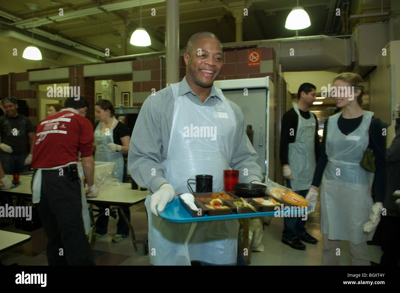 Volunteers serve Sunday lunch at the St. Francis Xavier Mission\'s ...