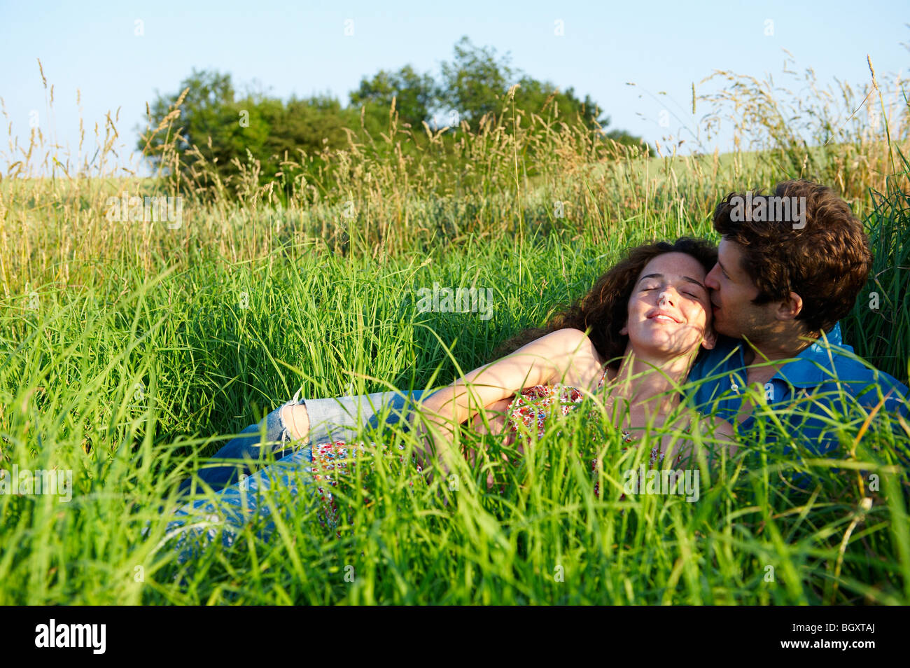 Couple in a wheat field Stock Photo