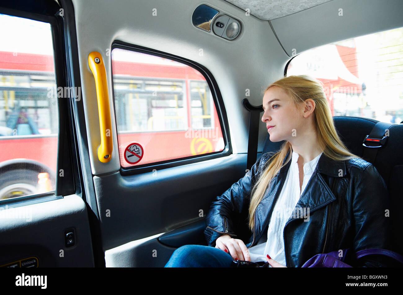 Woman in taxi - Stock Image