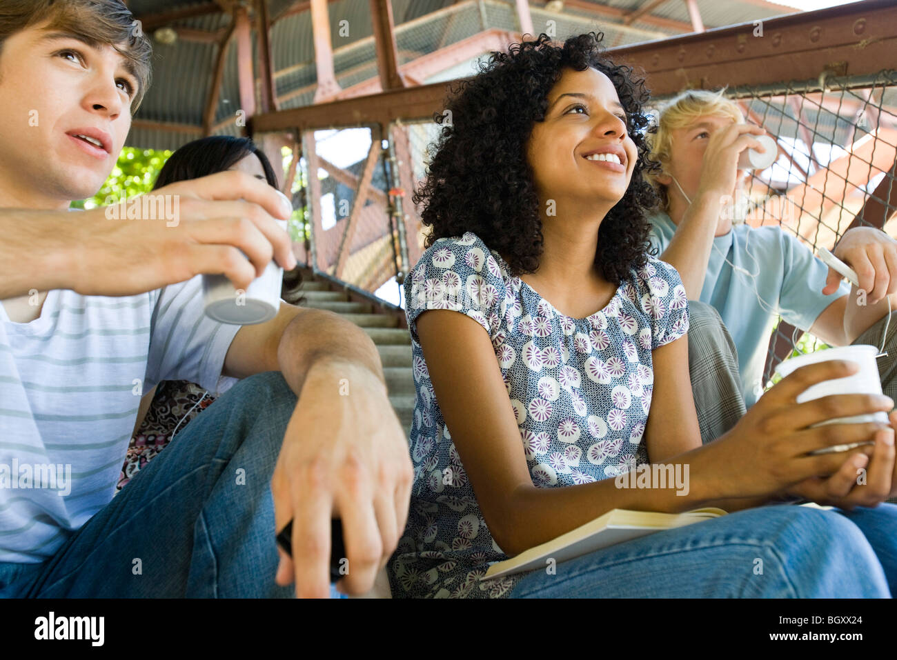 Young woman hanging out with friends watching sports event Stock Photo