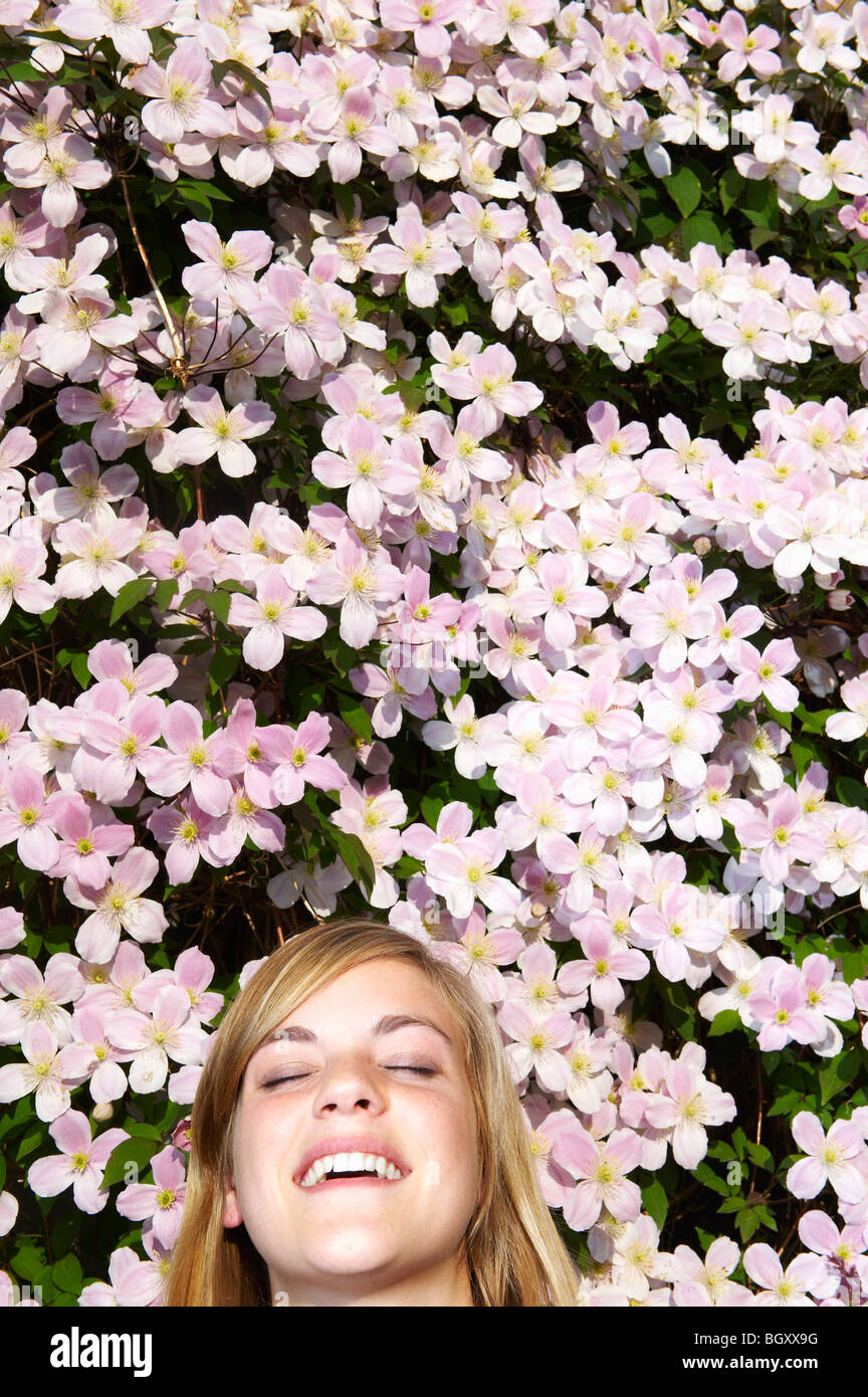 Woman laying down in the flowers Stock Photo