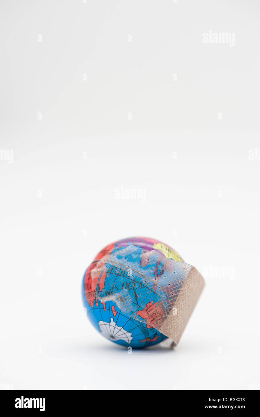 Adhesive bandage wrapped around globe - Stock Image
