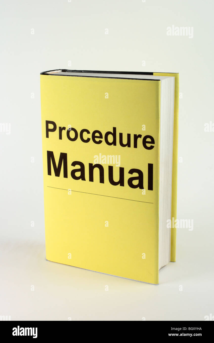Book with yellow cover thats says Procedure Manual - Stock Image