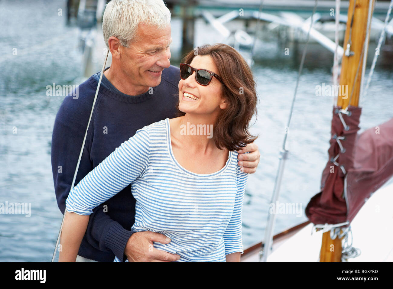 Middle aged couple on an old boat - Stock Image