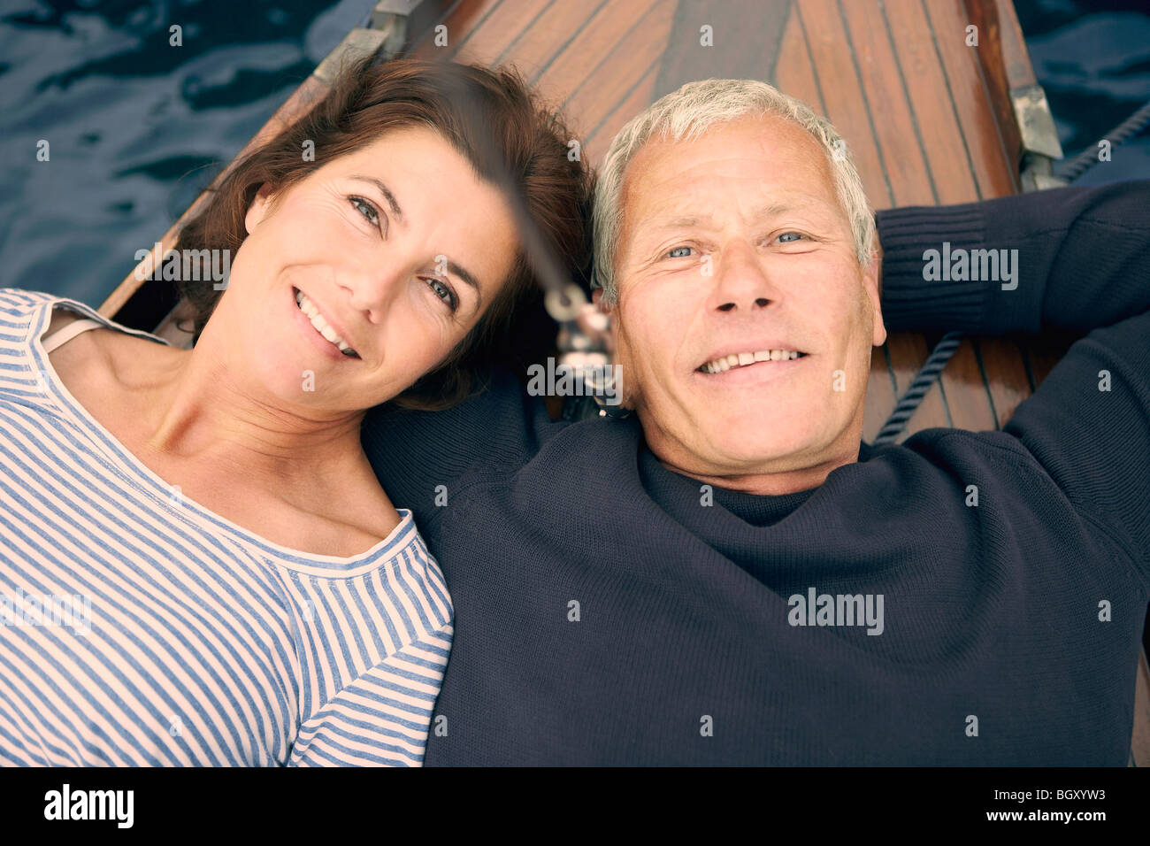 Middle aged couple on boat (portrait) Stock Photo