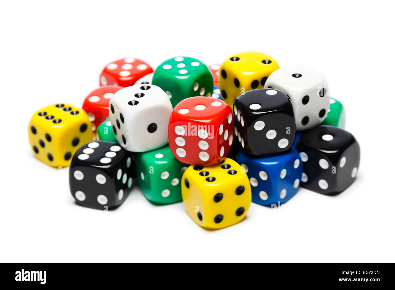 Dice pile - studio cut out on white background - Stock Image