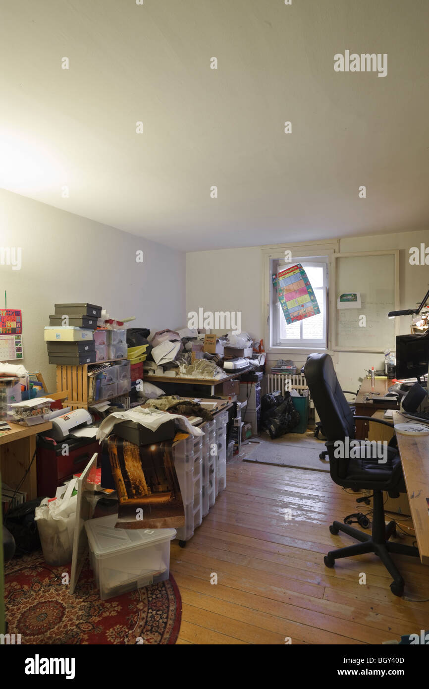Cluttered room used as a home office / hobby room - Stock Image