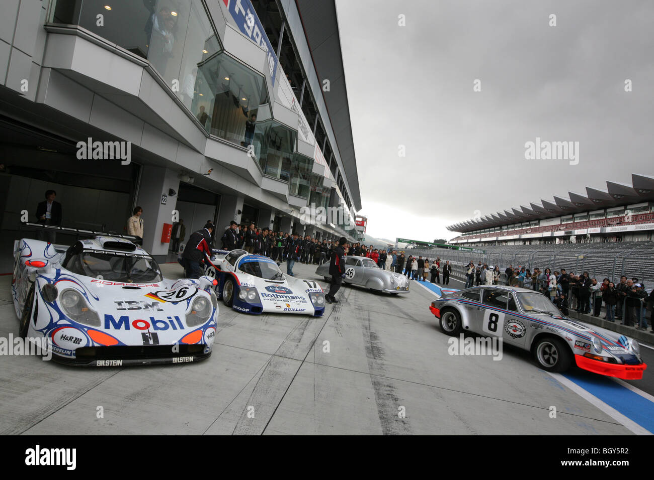 Porsche museum cars (left to right) - 1998 911 GT1 (Mobil), 1987 962C (Rothmans), 1951 356SL Coupe, and 1973 911 - Stock Image