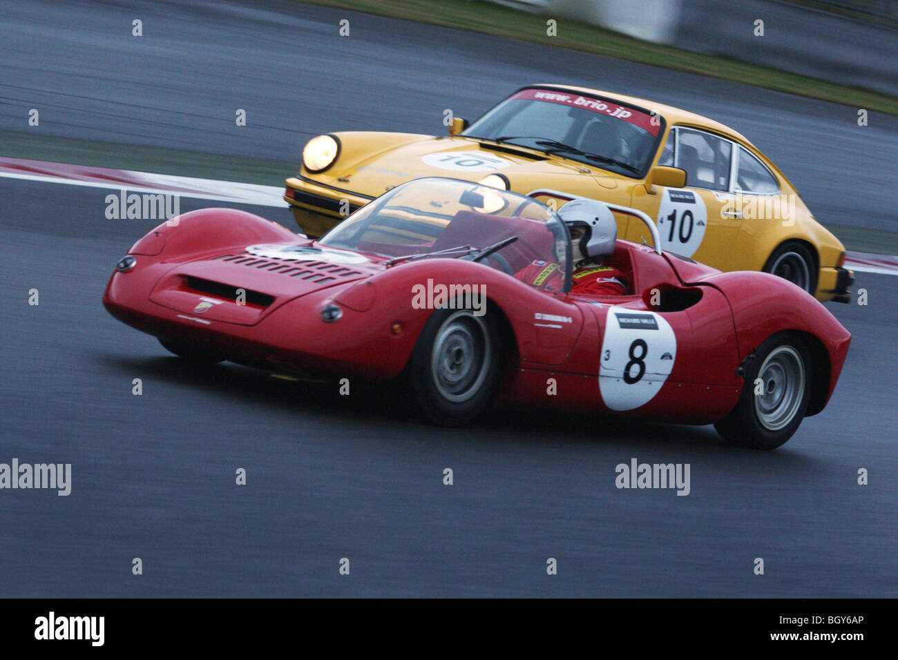 1974 Porsche 911 and a 1967 Abarth 1000SP. Le Mans Classic car race, Fuji Speedway, Japan, Saturday, November 10th, - Stock Image