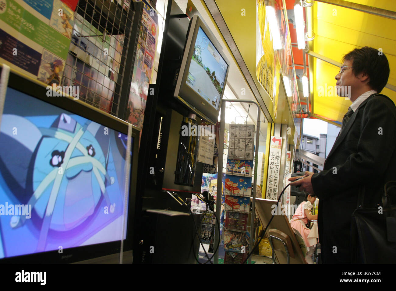 Customers try out the new PlayStation3 gaming console outside an electronics store in Akihabara 'Electric town', - Stock Image