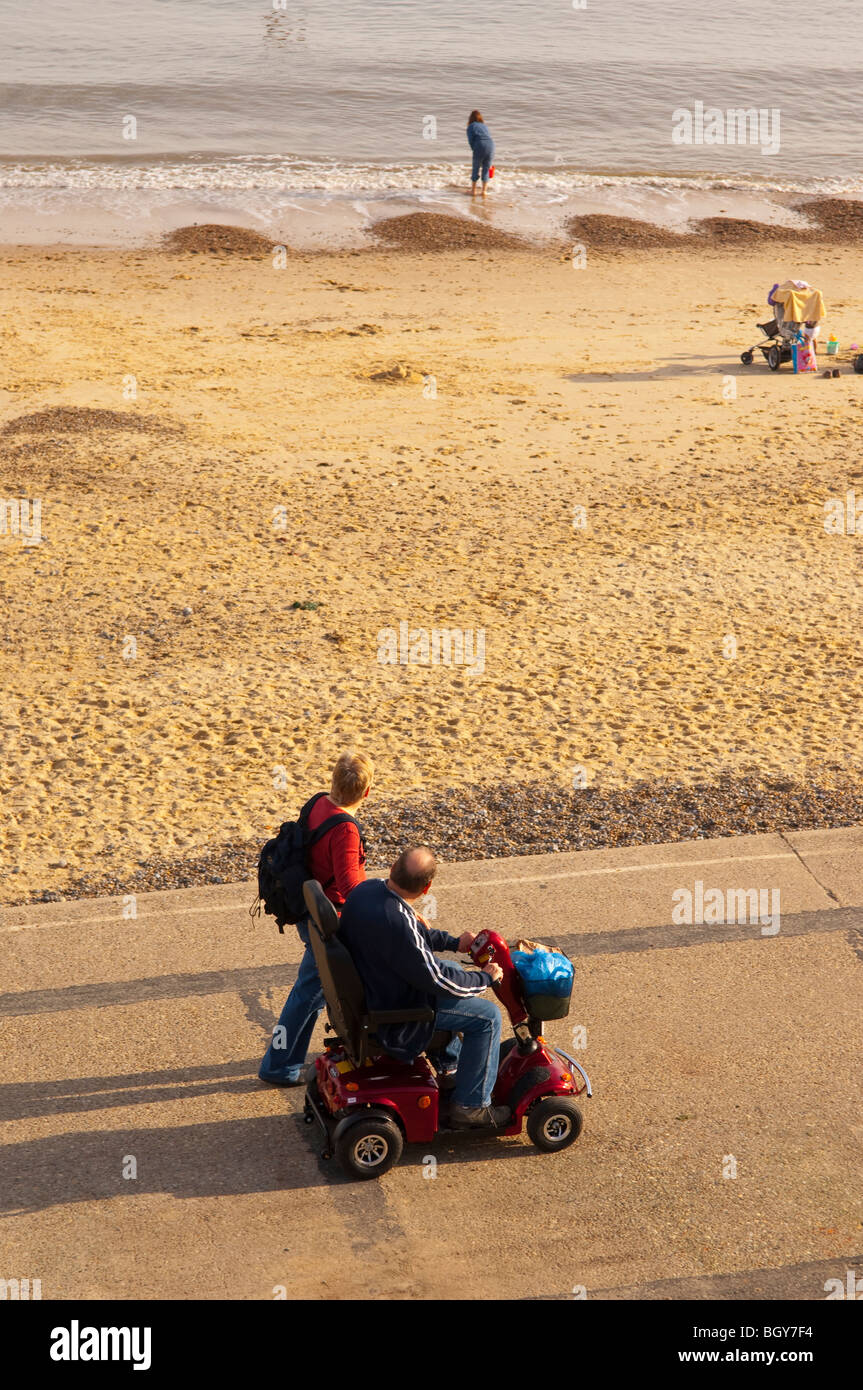 A man in a dissability buggy on the promenade in Southwold , Suffolk , England , Britain , Uk - Stock Image
